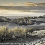 Evening at Saddlescombe by Edward Mills, shortlisted for SDNPA Photo Competition 2016/17 A crisp winter light falling across the valley creates lovely depths in this beautiful shot of Saddlescombe. A farm has existed on this site for at least 1000 years.