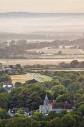 The historic village of Wilmington nestles at the foot of the Downs with a view across the Wilmington green and on to the Weald.