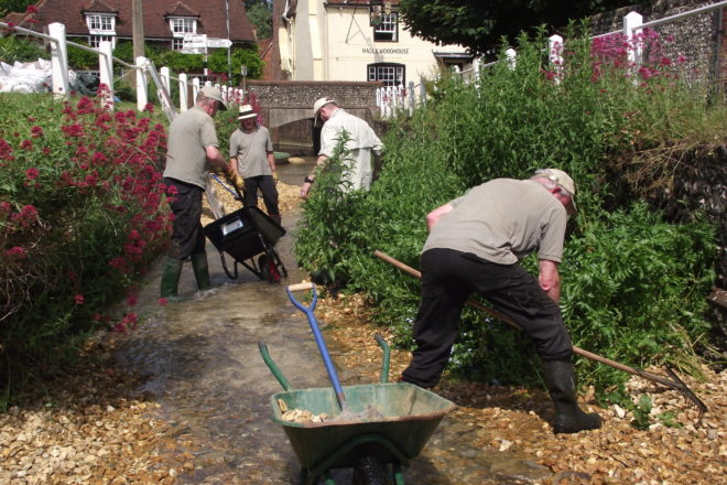 Image showing volunteers clearing the path of the River Meon in East Meon